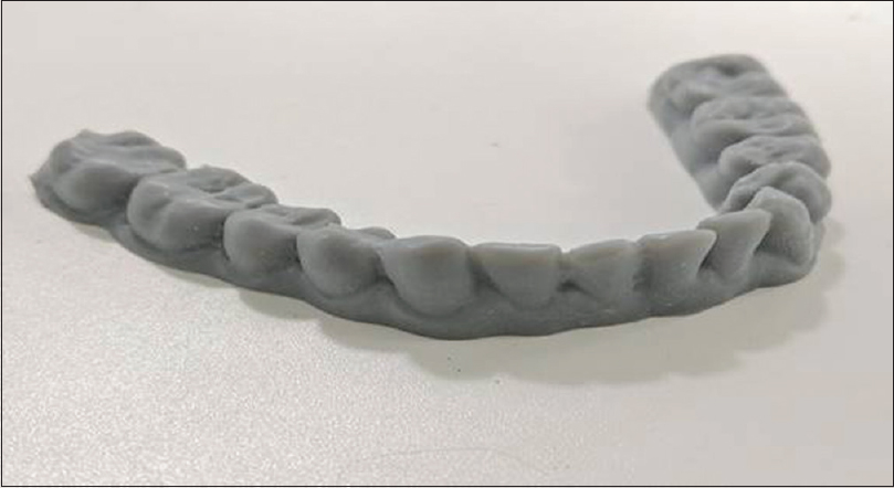 Figure 8: Three-dimensional printed mandible teeth line model along with made by stereolithography. Material used is Photopolymer Resin, biocompatible for <i>in vivo</i> applications. Machine used was desktop form laboratories stereolithography
